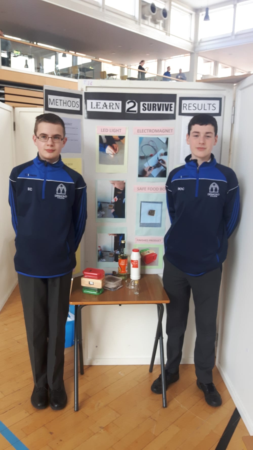 Rhys O'Connor and Eamon Conlon with their project Learn to Survive at SciFest in LIT