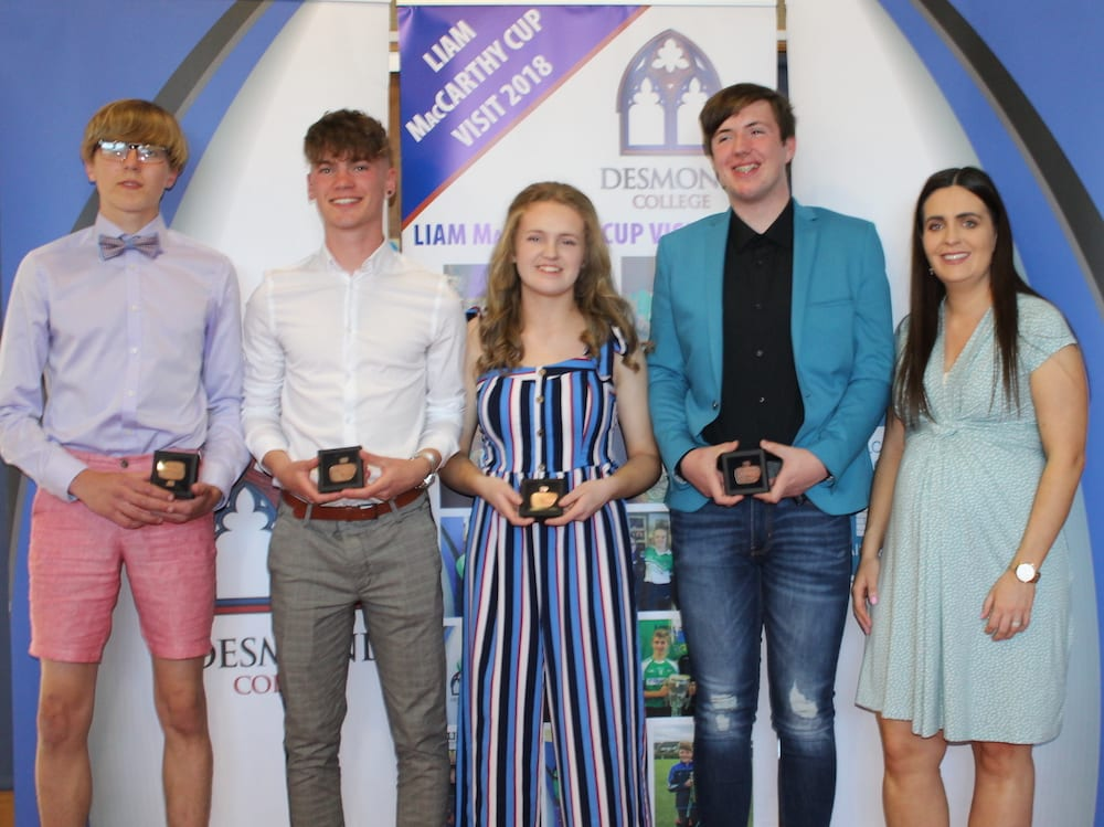 Cian Mason, Nathan Wright, Kayla McMahon and Cian Nolan receiving their Gaisce Award from Ms Culhane