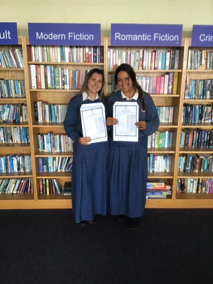 Desmond College students in School Library pleased with their results